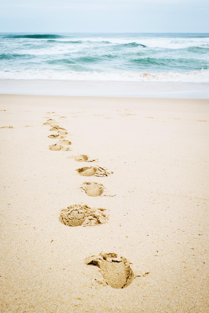 Fotspår i stranden