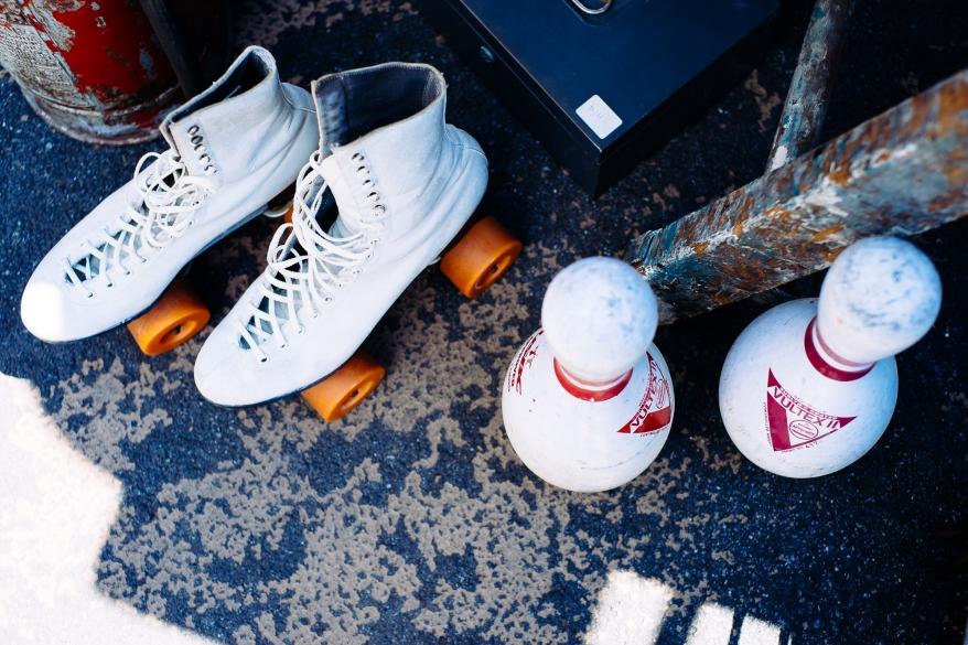 Roller skates and bowling pins