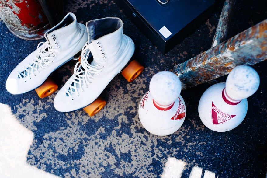 Roller skates and bowling pins
