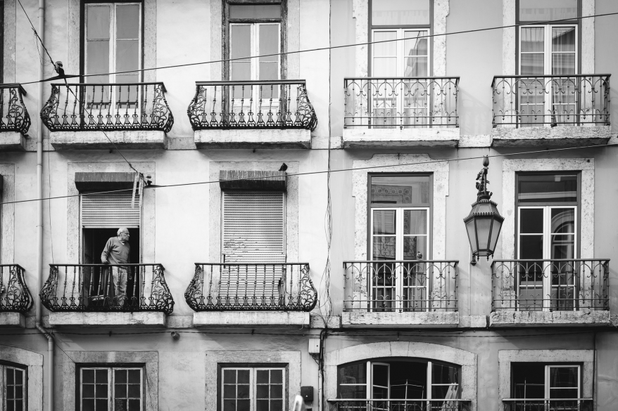 man on balcony, lisbon