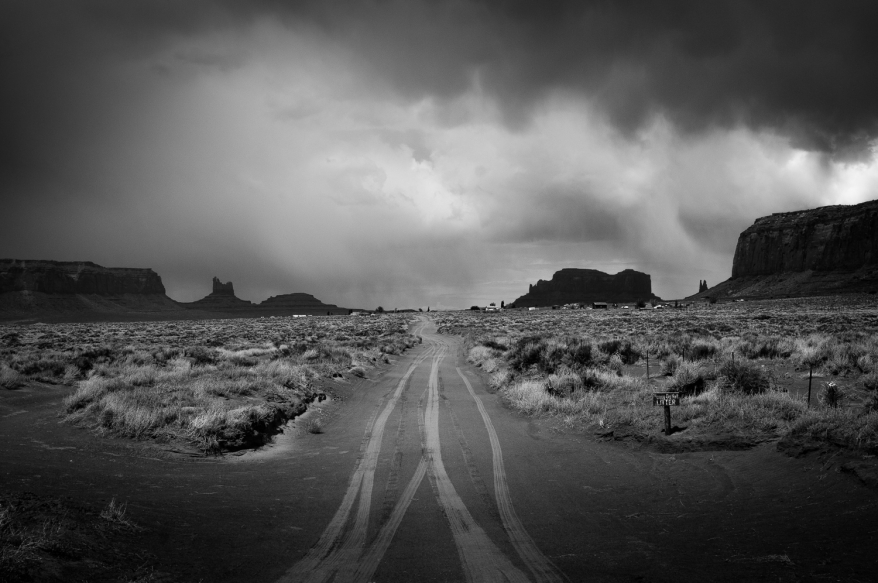 Dusty road with rock formations in the background. Photographer: Helena Bergqvist.