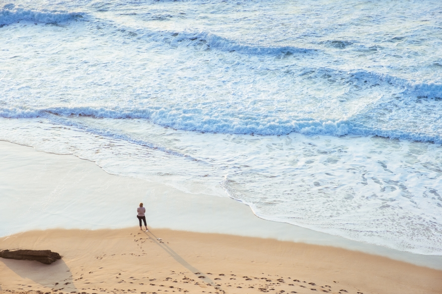 woman standing in front of the ocean