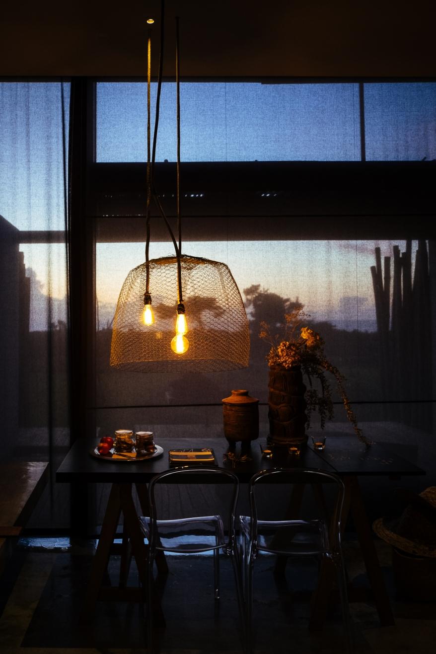 Window with garden and ocean in the background. Photographer: Helena Bergqvist.